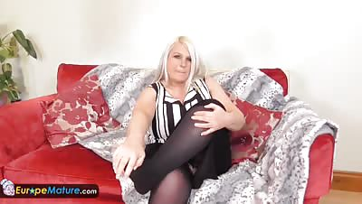 Mature blonde Lacey playing with huge tits