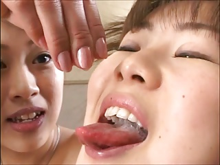 Three Japanese girls take turns eating cum