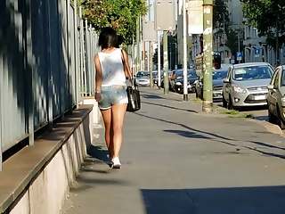 Girl wiggles her butt while walking